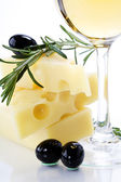 Olive, cheese and white wine — Stock Photo