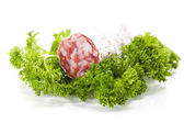 Salami and parsley — Stock Photo