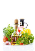 Vegetables still life with olive oil — Stock Photo
