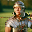 One Brave Roman soldier in field. - Stockfoto