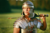 One Brave Roman soldier in field. — Stock Photo