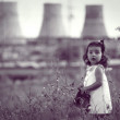 Little girl with a gas mask in hands — Stock Photo #1260561