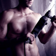 Strong brawny guy with electrodrill — Stock Photo