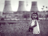 Little girl with a gas mask in hands — Stock Photo