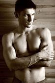 Sepia portrait of brawny gay — Stock Photo