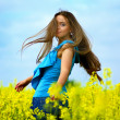 Attractive young woman on field — Stock Photo