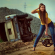 The girl with wheel in a hand - Photo