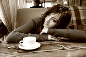 Attractive woman sits at table in coffee — Stock Photo