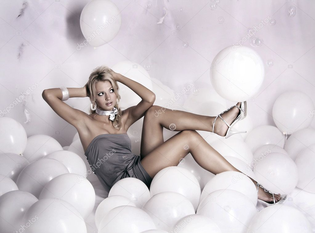 Glamour Girl With White Balloons Stock Photo