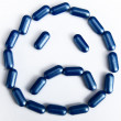 Stock Photo: Sad face made by pills