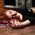 Dead young woman on wooden floor. Studio — Stock Photo