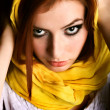 Royalty-Free Stock Photo: Red-haired beauty in a yellow scarf