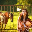 Modern rural girl. Country lifestyle. - Stock Photo