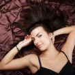 Glamour lady with long hair laying — Stock Photo