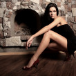 Sexual model near a fireplace — Stock Photo #1282649