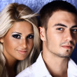 Young love couple smiling. Over blue — Stok fotoğraf