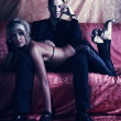 Stylish couple in fashionable room — Stock fotografie