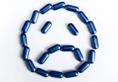 Sad face made by pills — Stock Photo