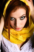 Red-haired beauty in a yellow scarf — Stock Photo