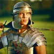 One Brave Roman soldier in field. - Stock Photo