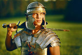 One Brave Roman soldier in field. — Stock fotografie