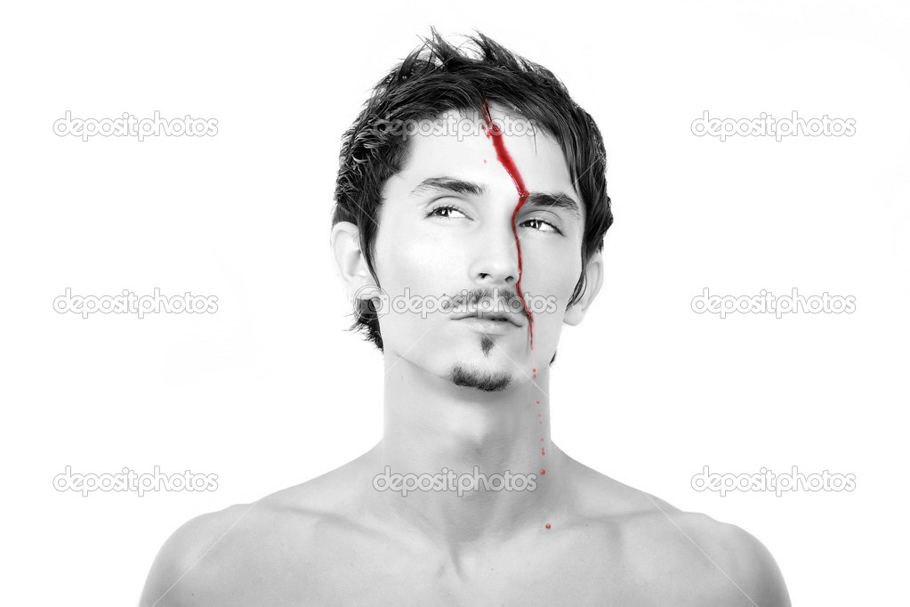  Young man face with bleeding from a head. Closeup image on white background.  Stock Photo #1656573