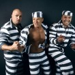 Foto de Stock  : Three prisoners.