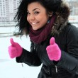 Positive young girl in pink gloves — Stock Photo