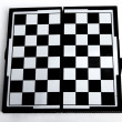 Chess board on white background. - Stock Photo