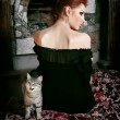 Stock Photo: House cat and red-haired girl sitting