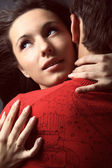 Two lovers over dark background — Stock Photo