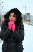 Attractive young girl in pink gloves — Stock Photo