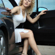Beautiful pin-up styled girl near car — Stock Photo
