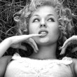 Carefree girl similar to Marylin Monro — Stock Photo