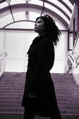 Charming brunette near ladder steps — Stock Photo