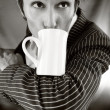 Stock Photo: Young macho in striped suit with cup