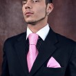 Young sexy macho in suit — Stock Photo #2203351