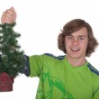 Teenager holds in a hand a Christmas fur — Stock Photo