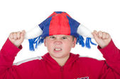 Offended boy in a fan helmet — Stock Photo