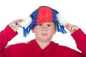 Dissatisfied boy in a fan helmet — Stock Photo
