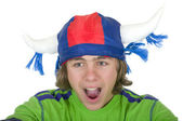 Teenager in a fan helmet — Stock Photo