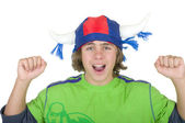 Happy teenager in a fan helmet — Stock Photo