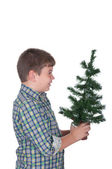 Boy holds in a hand a Christmas fur-tree — Stock fotografie