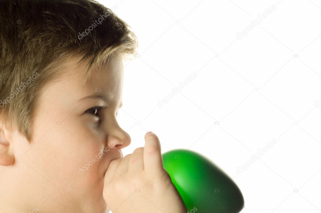 The boy inflates a balloon on a white background — Stock Photo #1238754