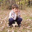 图库照片: Boy sits on ball