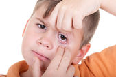 Little boy shows an eye — Stock Photo