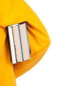 Tiener houdt boek onder de arm — Stockfoto