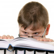 Boy in glasses with the book — Stock Photo #2539013