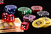 Poker chips with European cash money and dices — Stock Photo