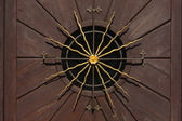 Golden sun on a wooden door — Stock Photo